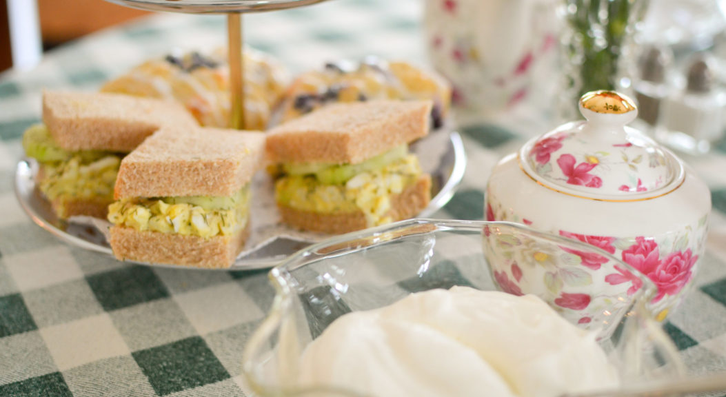 English tea hour has egg salad sandwiches and cookies